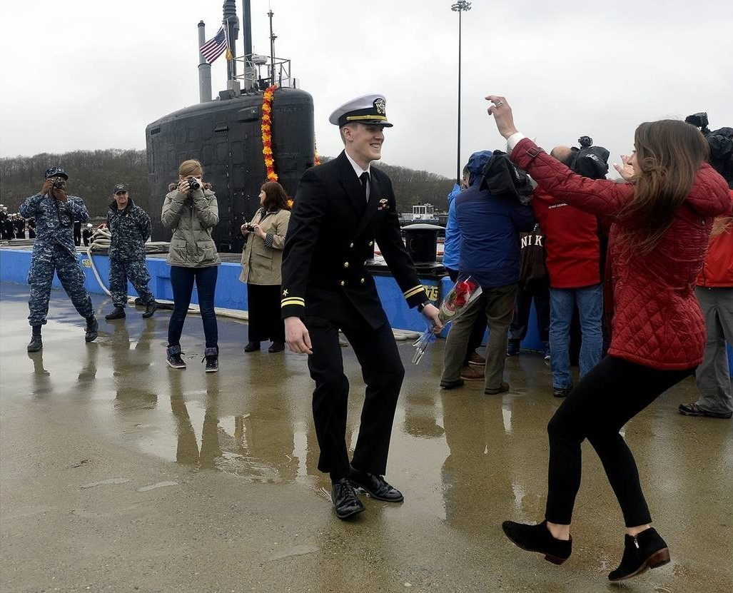 Ship Navigation Officer LTJG Keene runs to hug his wife after six months at sea