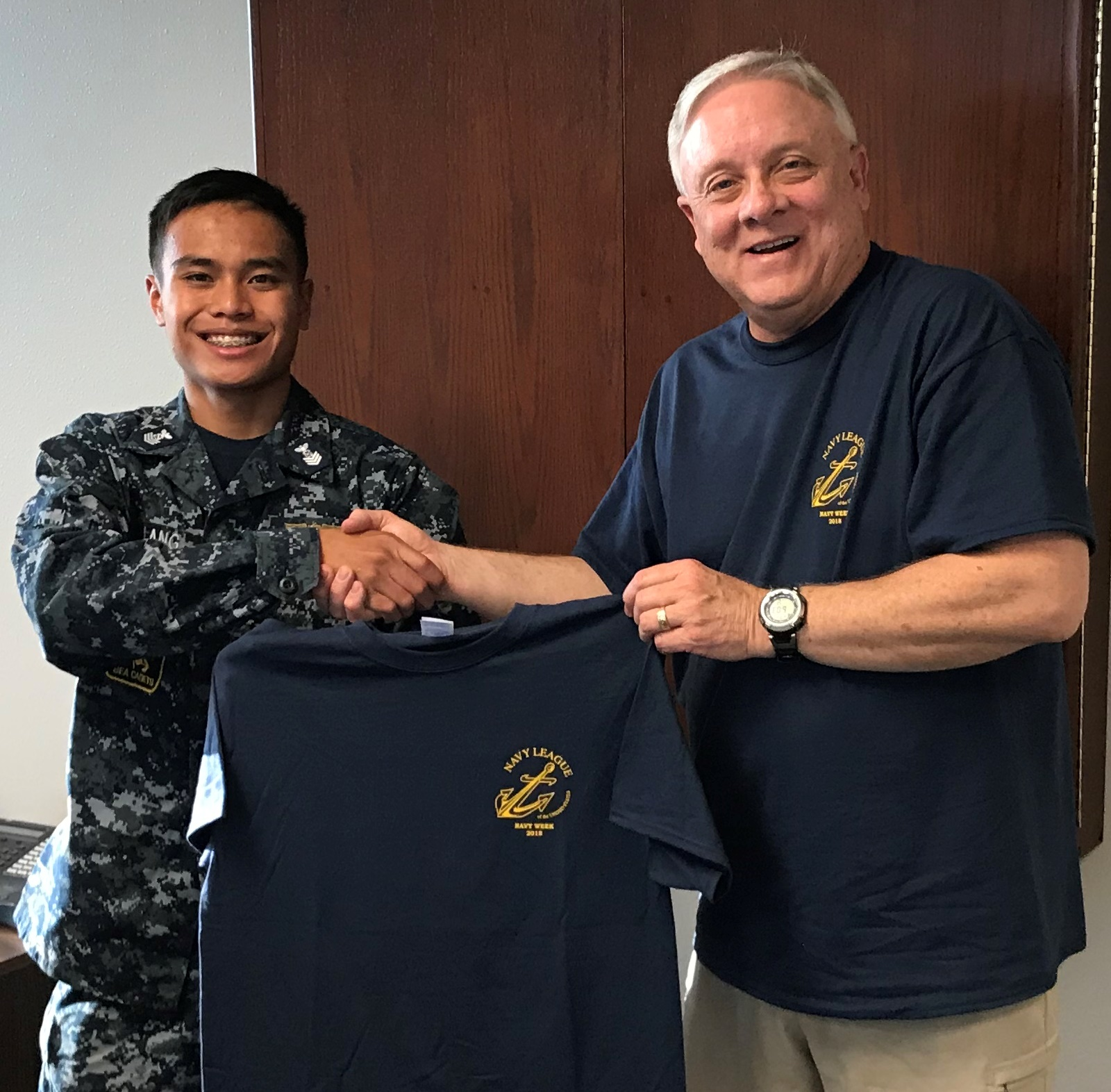 Sea Cadet PO1 Robby Galang receivng a Navy Week T-shirt 20Aug18